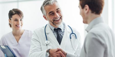 Doctor handshaking a patient